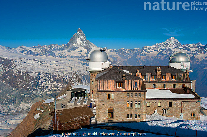 Gornergrat Station with observatory domes, Monte Rosa and Cervino (The Matterhorn) massif on the horizon, Pennine Alps, Switzerland, April 2011.  ,  ALPINE,ALPS,BLUE,BUILDINGS,EUROPE,LANDSCAPES,MOUNTAINS,OBSERVATORIES,PEAKS,SKY,SWITZERLAND  ,  Inaki Relanzon
