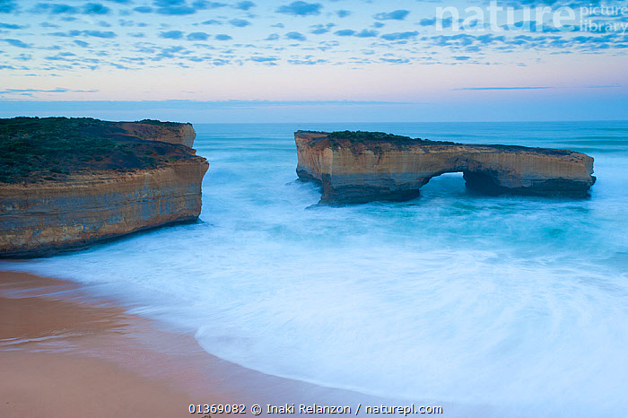 The London Bridge rock formation at sun rise, Great Ocean Road, Port Campbell National Park, Victoria State, Australia, September 2011.  ,  AUSTRALASIA,AUSTRALIA,BEACHES,CLIFFS,COASTS,DAWN,GEOLOGY,LANDSCAPES,NP,OCEANS,RESERVE,ROCKS,SAND,SUN,SUNSETS,WATER,National Park  ,  Inaki Relanzon