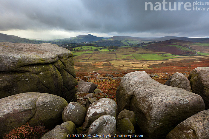 View from Over Owler Tor, an outcrop of gritstone. Peak District National Park, Debyshire, UK, October.  ,  AGRICULTURE,BOULDERS,CLOUDS,ENGLAND,EUROPE,FARMLAND,LANDSCAPES,MOODY,MOORLAND,NP,ROCKS,SCENIC,SKY,UK,Weather,National Park,United Kingdom  ,  Alex Hyde