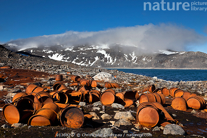 Rusty barrels at the historical site of Virgohamna where, in 1897, the hydrogen balloon 'Omen' (the Eagle) sailed northward in a failed attempt to reach the north pole with 3 Swedish ballooners led by S. A. Andree, Spitzbergen, Svalbard, Norway, July 2011  ,  abandoned,ADVENTURE,ageing process,ARCTIC,barrel,catalogue4,coastal,COASTS,environmental concern,EUROPE,expedition,Historic,HISTORICAL,LANDSCAPES,large group of objects,Nobody,NORWAY,oil drum,POLLUTION,Rusty,Scenic,spitsbergen,Spitzberg,spitzbergen,Svalbard,Virgohamma,Scandinavia  ,  Christophe Courteau
