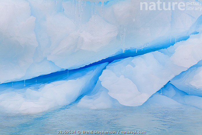 A large crack in an iceberg being lit by deep blue light filtering through the berg. Yalour Islands, Antarctic Peninsula, Antarctica, December.  ,  ANTARCTICA,CLIMATE CHANGE,GLOABL WARMING,ICE,MELT,POLAR,SNOW,THAW  ,  Brent Stephenson