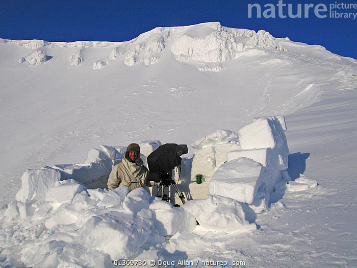 Wildlife cameraman Doug Allan in snow-blind, filming polar bears. Kong Karl's Land, Svalbard, Norway, April. Freeze frame book plate page 21.  ,  ARCTIC,FREEZE FRAME,LANDSCAPES,MOUNTAINS,NORWAY,OUTDOORS,PEOPLE,SNOW,SVALBARD,Europe,Scandinavia  ,  Doug Allan
