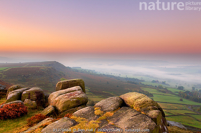 Scenic view from Curbar Edge at dawn, with mist in the distance and rock formations in the foreground, Peak District NP, UK, September 2011  ,  2020VISION,COLOURFUL,ENGLAND,LANDSCAPES,MIST,NP,SUNRISE,UK,ATMOSPHERIC,DAWN,EUROPE,MOORLAND,PEAK DISTRICT,ROCKS,SKY,National Park,United Kingdom  ,  Ben Hall / 2020VISION