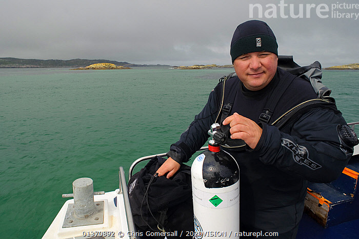 Portrait of underwater photographer Alex Mustard on board Sea Life Surveys boat Sula Crion preparing to dive, Cairns of Coll, Inner Hebrides, Scotland, Uk, July 2011  ,  2020VISION,DIVING,PEOPLE,SCOTLAND,SEAS,UK,ABOARD,BOATS,COASTAL WATERS,EUROPE,ONE PERSON,OUTDOORS,PHOTOGRAPHY,PORTRAITS,WORKING BOATS,United Kingdom  ,  Chris Gomersall / 2020VISION