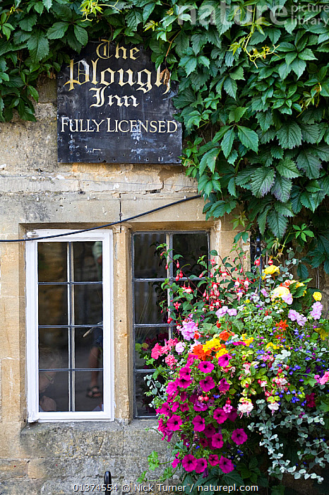 Outside view of The Plough Inn, Donnington, Gloucestershire, UK, July 2008.  ,  BUILDINGS,COTSWOLDS,ENGLAND,EUROPE,FLOWERS,LEISURE,PUBLIC HOUSES,PUBS,SIGNS,TOURISM,UK,VERTICAL,United Kingdom  ,  Nick Turner