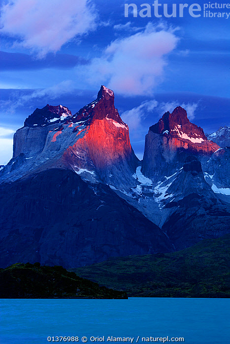 Cuernos del Paine at dawn seen from Pehoe lake, Torres del Paine National Park, Patagonia, Chile, Andes,ATMOSPHERIC,catalogue4,chile,cloudy,Cuernos del Paine,DAWN,HIGHLANDS,imposing,Lake,LAKES,LANDSCAPES,majestic,mountain peak,MOUNTAINS,national park,nature,Nobody,NP,patagonia,Pehoe Lake,RESERVE,ROCKS,Scenic,SKY,SNOW,SOUTH AMERICA,sunlight,Torres del Paine,Travel,VERTICAL,view to land,WATER, Oriol Alamany