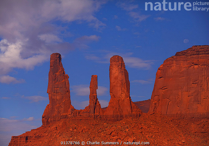 The 'Three Sisters' sandstone rock formations in morning light. Monument Valley, Arizona, September 2011.  ,  ARIZONA,CLIFFS,EROSION,ROCK FORMATIONS,ROCKS,USA,LANDSCAPES,MOUNTAINS,NORTH AMERICA,STACKS,Geology  ,  Charlie Summers