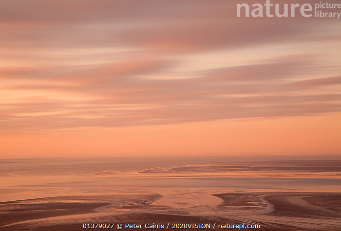 View across Morecambe Bay at dawn from Arnside, Cumbria, England, UK, February  ,  BLURRED,CLOUDS,COASTS,DAWN,EUROPE,MOVEMENT,MUDFLATS,SALTMARSHES,SKIES,SKY,2020VISION,DUSK,ENGLAND,LANDSCAPES,TIME EXPOSURE,UK,Weather,United Kingdom  ,  Peter Cairns / 2020VISION