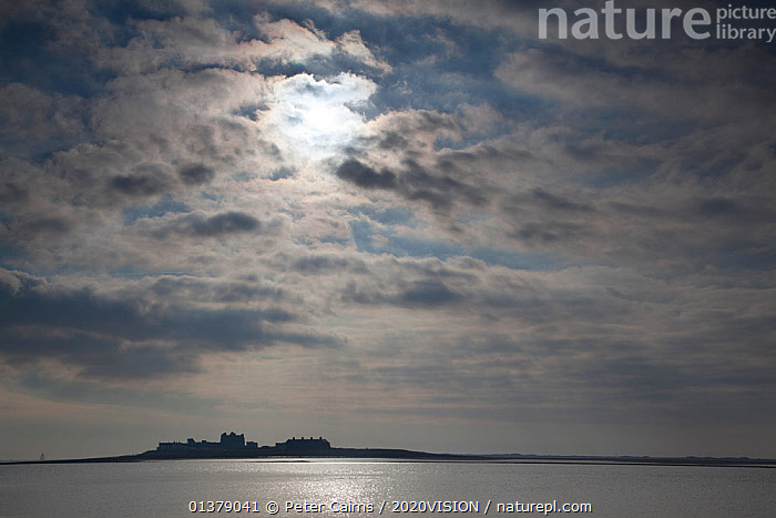 Piel Island silhouetted on the horizon, Morecambe Bay, Cumbria, England, UK, Februay  ,  2020VISION,ENGLAND,LANDSCAPES,SILHOUETTES,SUN,UK,CLOUDS,COASTS,EUROPE,MUDFLATS,SALTMARSHES,SKIES,SKY,Weather,United Kingdom  ,  Peter Cairns / 2020VISION