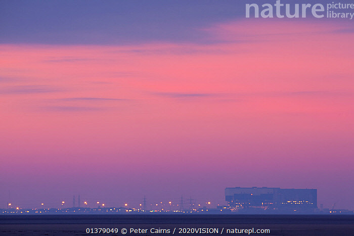 Sunset over the mudflats of Morecambe Bay at dusk, with the town of Morecambe in the distance, Lancashire, England, UK, February  ,  COASTS,DAWN,EUROPE,SALTMARSHES,SKIES,SKY,SUNSET,2020VISION,BUILDINGS,COLOURFUL,DUSK,ENGLAND,LANDSCAPES,SNOW,SUNRISE,UK,United Kingdom  ,  Peter Cairns / 2020VISION