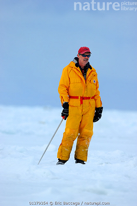 Portrait of tourist guide standing on sea ice, Magdalen Islands, Gulf of St Lawrence, Quebec, Canada, March 2012  ,  ATLANTIC,CANADA,CAUCASIAN,COASTAL WATERS,ICE,MAN,NORTH AMERICA,ONE PERSON,PEOPLE,PORTRAITS,SEA,TOURISM,YELLOW,Marine  ,  Eric Baccega