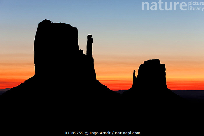 East and West Mittens, Monument Valley, Navajo Tribal Park, Arizona, USA, September 2010  ,  DAWN,DESERTS,DUSK,EVENING,LANDMARK,LANDSCAPES,NORTH AMERICA,ROCK FORMATIONS,SILHOUETTE,SILHOUETTED,SUNRISE,SUNSET,TRAVEL,USA  ,  Ingo Arndt
