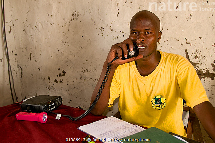 Ranger of the Ishaqbini Reserve Northern Rangelands Trust at the headquarters, speaking on the radio. Kenya.  ,  AFRICA,CONSERVATION,EAST AFRICA,INDOORS,KENYA,NP,PEOPLE,RANGERS,RESERVE,National Park  ,  Roland Seitre