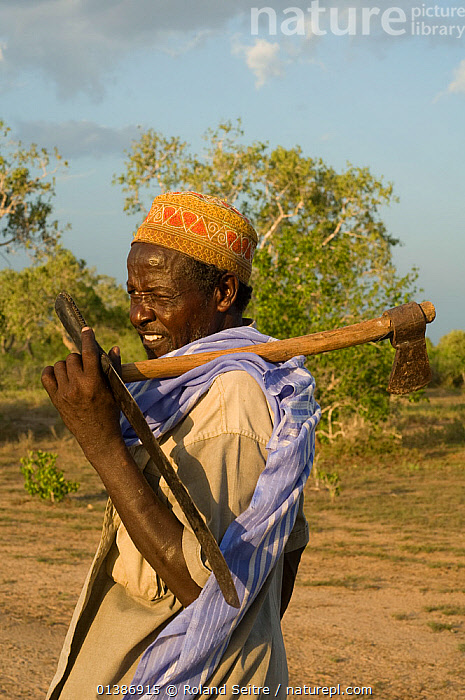 Man with axe, returning from gathering fire wood. Ishaqbini Reserve, Kenya, 2009.  ,  AFRICA,EAST AFRICA,KENYA,NP,OUTDOORS,PEOPLE,RESERVE,TRADITIONAL,TRIBES,VERTICAL,National Park  ,  Roland Seitre