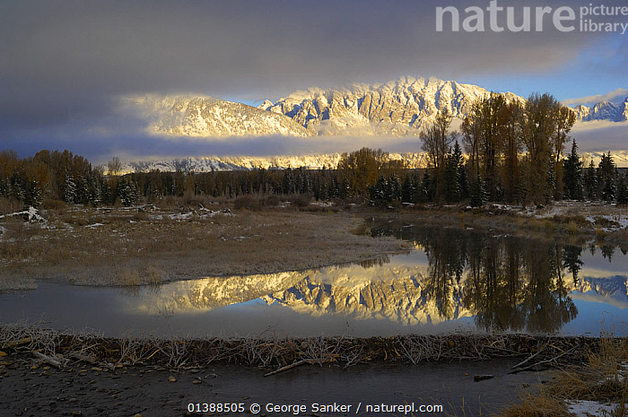 Grand Teton mountains reflected in Snake river, Grant Teton NP, Wyoming, USA, October 2009  ,  ATMOSPHERIC,CLOUDS,LANDSCAPES,MOUNTAINS,NORTH AMERICA,NP,REFLECTIONS,RIVERS,ROCKY MOUNTAINS,SNOW,USA,WATER,Weather,National Park ,Rocky Mountains,  ,  George Sanker