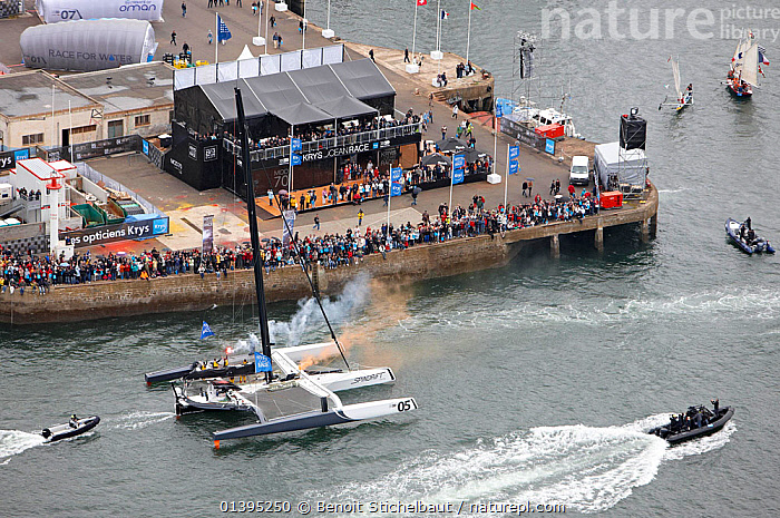 Spectators gathered to watch 'Spindrift Racing' arrive in Brest following transatlantic crossing from New York, during the Krys Ocean Race, France, July 2012. All non-editorial uses must be cleared individually.  ,  AERIALS,BOATS,BUILDINGS,COASTS,EUROPE,FRANCE,LARGE,MAXI,MOD70,MOD 70,MULTIHULLS ,PEOPLE,RACES,SAILING BOATS,SPECTATORS,TRIMARANS,YACHTS,SIZE  ,  Benoit Stichelbaut