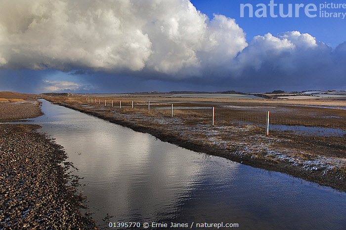 View of Creek at Salthouse, Norfolk, UK, Febraury 2010.  ,  CLOUDS,COUNTRYSIDE,ENGLAND,EUROPE,FLAT ,LANDSCAPES,MARSHES,REFLECTIONS,SKY,SNOW,UK,WATER,WINTER,Weather,Wetlands,United Kingdom  ,  Ernie Janes