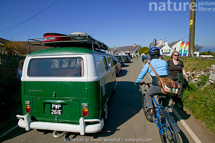 Holiday traffic queing for coastal car park, including camper van and cyclist, Rhosilli, Gower, South Wales, April 2009  ,  CARS,COASTS,CONGESTION,DESTINATION,EASTER,EUROPE,HOLIDAYS,PEOPLE,POPULAR,POPULATION,QUEUES,ROADS,SOUTH WALES,TRAFFIC,TRANSPORT,TRAVEL,UK,VEHICLES,WALES,Concepts,United Kingdom  ,  David Woodfall
