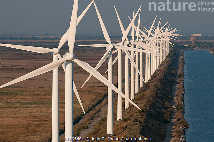 Aerial view of wind turbines of wind farm on the Camargue, Port Saint Louis du Rhone, Southern France, September 2008  ,  AERIALS,CAMARGUE,COASTS,ENERGY,ENVIRONMENTAL,EUROPE,FRANCE,LANDSCAPES,MARSHES,MEDITERRANEAN,RENEWABLE ENERGY,WETLANDS,WIND,WINDMILLS,Weather,Catalogue5  ,  Jean E. Roche