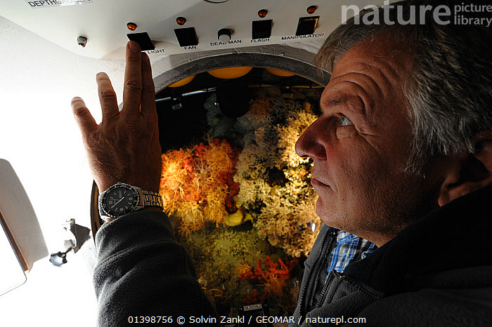 Jurgen Schauer pilot of the submersible JAGO on a dive with corals visible through the viewport. Atlantic ocean, Norway, September 2011, editorial use only. Photo taken in cooperation with GEOMAR coldwater coral research project  ,  ATLANTIC,COLD,CORALS,DEEPSEA,DIVING,EUROPE,INVERTEBRATES,MAN,MARINE,NORWAY,PEOPLE,POLAR,RESEARCH,SCANDINAVIA,SCIENCE,SUBMERSIBLES,UNDERWATER,BOATS  ,  Solvin Zankl / GEOMAR