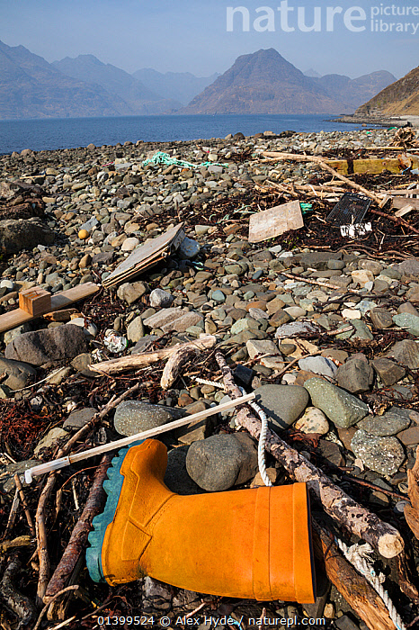 Rubbish washed up on a beach, Isle of Skye, Inner Hebrides, Scotland, UK, March 2012.  ,  BEACHES,BOOT,BOOTS,COASTS,ENVIRONMENTAL,FLOTSAM,INNER HEBRIDES,LANDSCAPES,RUBBISH,SCOTLAND,SEASCAPES,SKYE,TRASH,VERTICAL,WASTE,Europe,UK,United Kingdom  ,  Alex Hyde