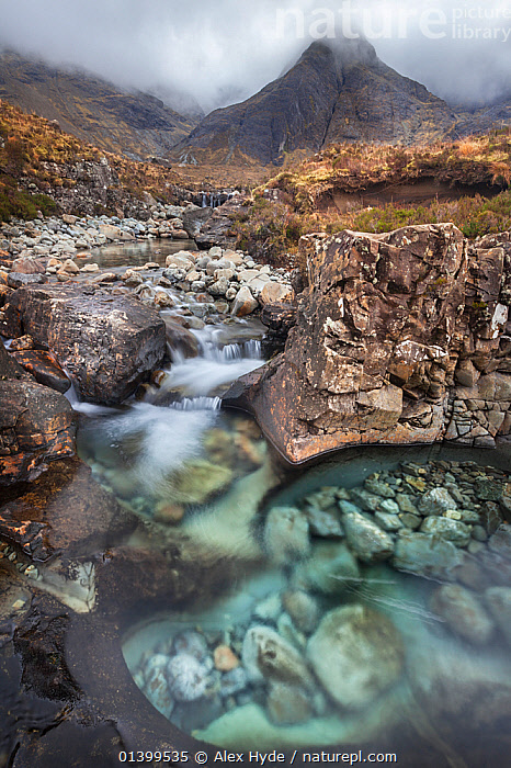 Waterfalls along the course of the Allt Coir' a' Mhadaidh river as it cascades down from the Cullin Hills. Glen Brittle, Isle of Skye, Inner Hebrides, Scotland, UK, March 2012.  ,  ATMOSPHERIC,CALM,EUROPE,LANDSCAPES,MOTION BLUR,RAPIDS,RIVERS,ROCKS,SCOTLAND,STREAMS,UK,VERTICAL,WATER,WATERFALLS,United Kingdom  ,  Alex Hyde