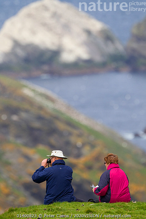 People watching Gannet (Sula bassana) colony. Hermaness National Nature Reserve, Shetland, Scotland.  ,  2020VISION,BIRDING,BIRDWATCHING,COASTS,EUROPE,LEISURE,NP,OUTDOORS,PEOPLE,RESERVE,SCOTLAND,SEAS,SHETLAND,TOURISM,TWO,UK,VERTICAL,National Park,United Kingdom,2020cc  ,  Peter Cairns / 2020VISION
