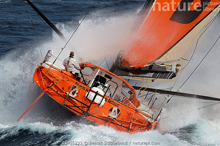 IMOCA 60 'PRB' skippered by Vincent Riou in heavy seas ahead of the Vendee Globe, Ile des Gl�nans, France, September 2012. All non-editiorial uses must be cleared individually.  ,  BOATS,CHOPPY,CREWS,EUROPE,EXTREME,HEAVY SEAS,MEN,MS,OPEN 60,PEOPLE,REAR VIEWS,SAILING BOATS,SOLO,SPLASHES,SPRAY,STORMS,WAVES,WEATHER,WET,YACHTS,SAILING-BOATS  ,  Benoit Stichelbaut