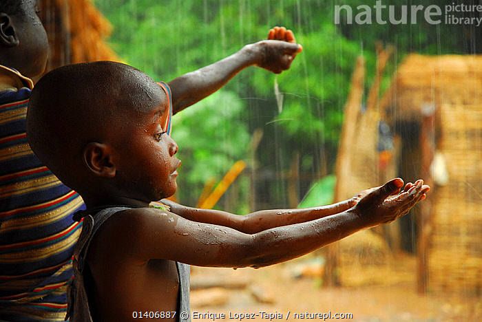 A bassari child holding out hands to collect rainwater, Bassari country,  east Senegal. This area became a UNESCO World Heritage site in 2012, for cultural landscape and traditions kept by the the Bassari, Fula and Bedik peoples. September 2006. No release available. Lux Awards competition 2012.  ,  AFRICA,CHILDREN,CULTURES,PEOPLE,RAIN,RAINING,STORMS,TRIBES,UNESCO,VILLAGES,WATER,WEST AFRICA,WET SEASON,Weather,Lux Awards 2012,Catalogue5  ,  Enrique Lopez-Tapia