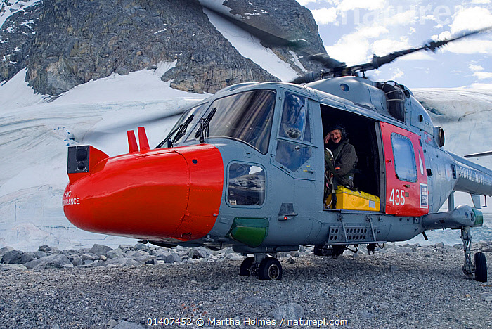 Producer Martha Holmes in Royal Navy helicopter. Antarctic Peninsula. February 2008. Taken on location for BBC tv series 'Life'  ,  AIR TRAVEL,AIRCRAFT,ANTARCTICA,HELICOPTER,NAVAL,PEOPLE,PHOTOGRAPHER,PHOTOGRAPHY,POLAR,TRANSPORT,TRANSPORTATION,WOMAN  ,  Martha Holmes
