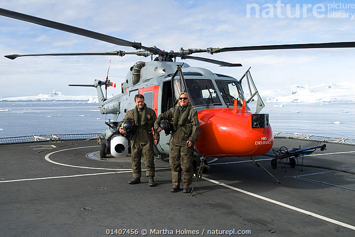 Aerial cameraman David Baillie and producer Martha Holmes on flight deck of HMS Endurance, standing by helicopter mounted with Gyron (stabilised aerial camera). February 20008. Taken on location for BBC tv series 'Life'  ,  ABOARD,AIRCRAFT,ANTARCTICA,BOATS,FILMING,HELICOPERS,MAN,NAVAL,PEOPLE,PHOTOGRAPHY,POLAR,SHIPS,WOMAN  ,  Martha Holmes