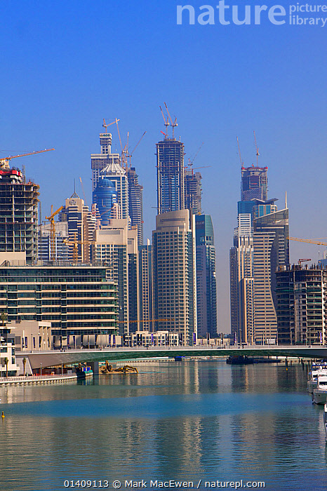 View of Dubai Marina and buildings under construction, Dubai, UAE, January 2010, ARABIA,ASIA,BRIDGES,BUILDINGS,CITIES,DUBAI,LANDSCAPES,MARINAS,MIDDLE EAST,UAE,UNITED ARAB EMIRATES,URBAN,VERTICAL, Mark MacEwen