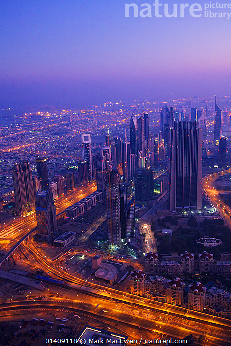 Aerial View of Dubai city early morning, looking towards Sheikh al zayed road, Dubai, UAE. January 2010. No release available., AERIALS,ARABIA,ASIA,BUILDINGS,CITIES,DUBAI,LANDSCAPES,LIGHTS,MIDDLE EAST,UAE,UNITED ARAB EMIRATES,URBAN,VERTICAL,Catalogue5, Mark MacEwen