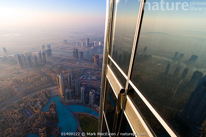 View from Burj Kalifa, the world's tallest building, Dubai at sunrise. United Arab Emirates (UAE) January 2010. No release available., ARABIA,ASIA,BUILDINGS,CITIES,DUBAI,LANDSCAPES,MIDDLE EAST,REFLECTIONS,UAE,UNITED ARAB EMIRATES,URBAN,WINDOWS,Catalogue5, Mark MacEwen