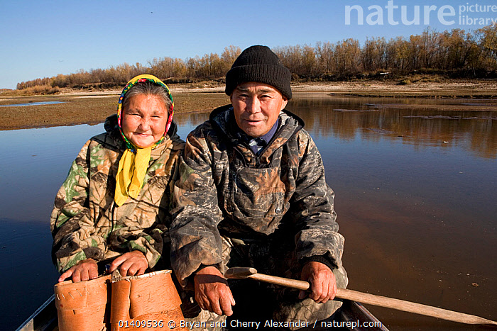 Selkup couple, Andrey Kargochev and his wife, Ludmilla, about to go berry picking by boat in the autumn, Tolka, Krasnoselkup, Yamal, Western Siberia, Russia, ABOARD,ARCTIC,ASIA,AUTUMN,BASKETS,BERRIES,BOATS,CIS,COUPLE,CULTURES,FEMALES,FOOD,HARVESTING,INDIGENOUS,MALE FEMALE PAIR,MALES,MARRIED ,NATIVE,PEOPLE,PORTRAITS,RIVERS,RUSSIA,SELKUP,SIBERIA,TRADITIONAL,TRANSPORT,TRAVELLING,TRIBAL,TRIBES,WATER,WESTERN SIBERIA ,Tribes,, Bryan and Cherry Alexander