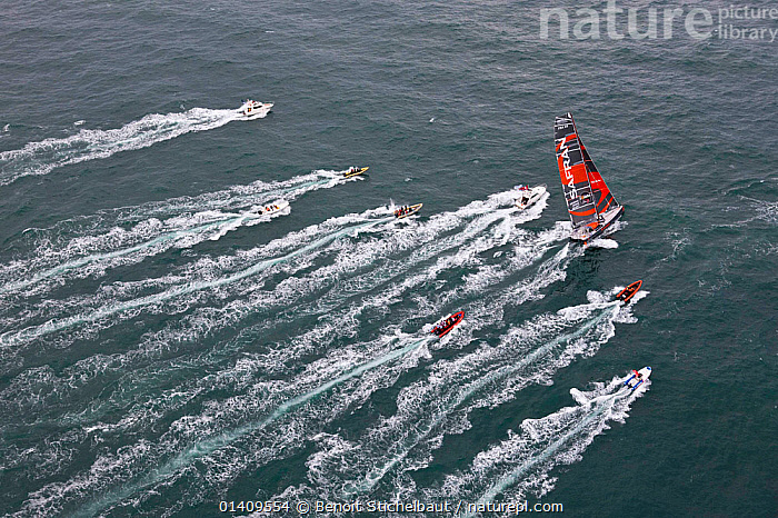 Aerial view of IMOCA 60 'Safran' skippered by Marc Guillemot starting the Vendee Globe from Les Sables d'Olonne, France, November 2012. All non-editorial uses must be cleared individually., AERIALS,BOATS,CIRCUMNAVIGATION,EUROPE,FRANCE,OPEN 60,RACES,RACING,SAILING BOATS,SOLO,STARTS,WAKE,YACHTS,SAILING-BOATS, Benoit Stichelbaut