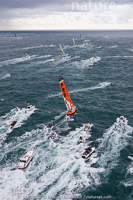 Aerial view of IMOCA 60 'PRB' skippered by Vincent Riou starting the Vendee Globe from Les Sables d'Olonne, France, November 2012. All non-editorial uses must be cleared individually., AERIALS,BOATS,CIRCUMNAVIGATION,EUROPE,FRANCE,OPEN 60,RACES,RACING,SAILING BOATS,SOLO,STARTS,VERTICAL,WAKE,YACHTS,SAILING-BOATS, Benoit Stichelbaut