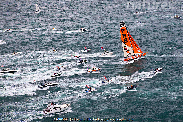Aerial view of IMOCA 60 'PRB' skippered by Vincent Riou starting the Vendee Globe from Les Sables d'Olonne, France, November 2012. All non-editorial uses must be cleared individually., AERIALS,BOATS,CIRCUMNAVIGATION,EUROPE,FRANCE,OPEN 60,PROFILE,RACES,RACING,SAILING BOATS,SOLO,STARTS,WAKE,YACHTS,SAILING-BOATS, Benoit Stichelbaut
