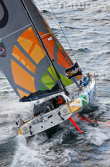 Aerial view of IMOCA 60 'Gamesa' skippered by Mike Golding starting the Vendee Globe from Les Sables d'Olonne, France, November 2012. All non-editorial uses must be cleared individually., AERIALS,BOATS,CHOPPY,CIRCUMNAVIGATION,EUROPE,FRANCE,HEELING,MS,OPEN 60,RACES,REAR VIEWS,SAILING BOATS,SOLO,VERTICAL,YACHTS,SAILING-BOATS, Benoit Stichelbaut