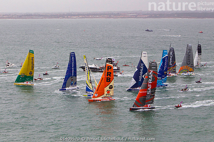 Aerial view of IMOCA 60 fleet starting the Vendee Globe from Les Sables d'Olonne, France, November 2012. All non-editorial uses must be cleared individually., AERIALS,BOATS,CIRCUMNAVIGATION,COASTS,EUROPE,FLEETS,FORESAILS,FRANCE,LANDSCAPES,MAINSAILS,OPEN 60,PROFILE,RACES,RACING,SAILING BOATS,SOLO,STARTS,YACHTS,SAILING-BOATS, Benoit Stichelbaut