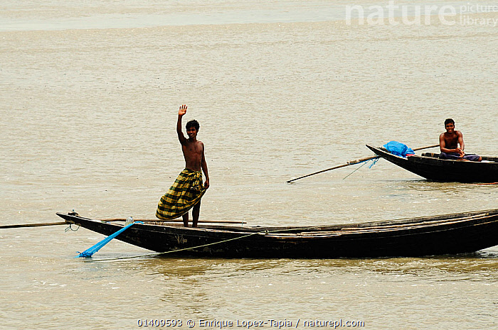 Man waving from a boat, Sundarbans National Park, the largest mangrove swamp in the world. Bangladesh. UNESCO World Heritage Site. June 2012., ASIA,BANGLADESH,BOATS,FISHING BOATS,HAPPY,NP,OPEN BOATS,PEOPLE,RESERVE,RIVERS,TRADITIONAL,WAVING,WOODEN,INDIAN-SUBCONTINENT,National Park, Enrique Lopez-Tapia