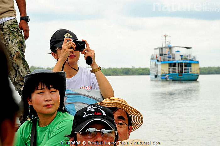 Japanese tourists taking photographs in Sundarbans National Park, the largest mangrove swamp in the world. Bangladesh UNESCO World Heritage Site. June 2012., ABOARD,ASIA,BANGLADESH,BOATS,ECOTOURISM,FERRIES,NP,PEOPLE,PHOTOGRAPHY,RESERVE,RIVERS,SWAMPS,TOURISM,WORKING BOATS,INDIAN-SUBCONTINENT,WORKING-BOATS ,National Park,Wetlands, Enrique Lopez-Tapia
