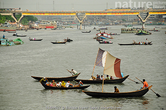 Boats on the Sadarghat water front, Dhaleshwari river, with a bridge in the background. Dhaka, Bangladesh, June 2012., ASIA,BANGLADESH,BOATS,BRIDGES,CITIES,FISHING BOATS,LANDSCAPES,MIXED BOATS,PEOPLE,RIVERS,TRADITIONAL,URBAN, Enrique Lopez-Tapia