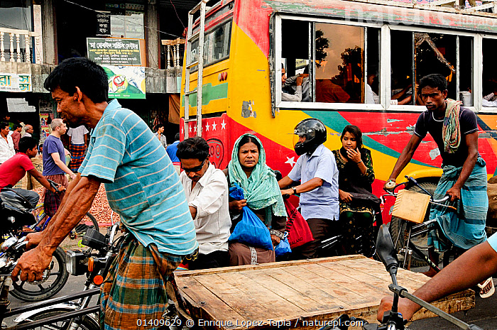 A busy street with people walking,  and cycling through Dhaka, Bangladesh, June 2012., ASIA,BANGLADESH,BICYCLES,BUSY,CITIES,CROWDED,CYCLING,MEN,PEOPLE,POPULATION,TRANSPORT,TRANSPORTATION,URBAN,VEHICLES,WOMEN, Enrique Lopez-Tapia