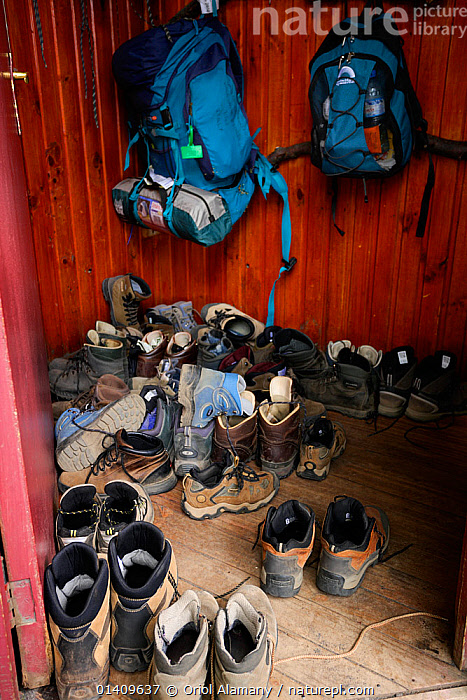 Hiking boots and backpacks at the entrance of Grey mountain hut, trekking in National Park Torres del Paine, Patagonia, Chile, BAGS,BOOTS,HIKING,MOUNTAINEERING,NP,PEOPLE,RESERVE,SHOES,SOUTH AMERICA,SPORTS,National Park, Oriol Alamany