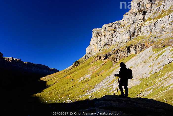 Lone hiker silhouetted in the shadows of Ordesa valley, Ordesa and Monte Perdido National Park, Pyrenees, Aragon, Spain, EUROPE,HIKING,MOUNTAINS,NP,ONE,RESERVE,SHADOWS,SILHOUETTES,SPAIN,TREKKING,VALLEYS,WALKING,National Park,,UNESCO World Heritage Site,, Oriol Alamany