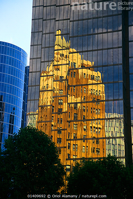 Antique skyscraper reflected in the glass windows of a modern skyscraper in Burrad Street, Vancouver city, British Columbia, Canada, BUILDINGS,CANADA,CITIES,MODERN,NEW,NORTH AMERICA,OLD,REFLECTIONS,URBAN,WINDOWS, Oriol Alamany