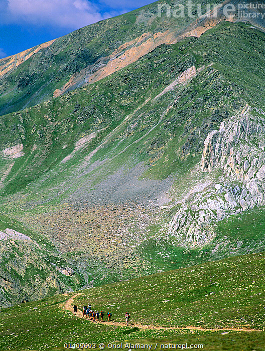 Mountain walkers below Bastiments peak (2881 m) walking the Nuria-Ulldeter trail, Ripollas, Pyrenees, Catalonia, Spain, EUROPE,HIKERS,HIKING,LANDSCAPES,MOUNTAINS,PATHS,PEOPLE,SPAIN,TREKKING,VERTICAL,WALKING, Oriol Alamany
