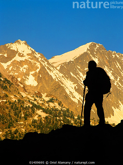 Woman hiker silhouetted at sunrise in Conangles valley, Aran Valley, Pyrenees, Catalonia, Spain. Model released, EUROPE,HIKING,LANDSCAPES,MOUNTAINEERING,MOUNTAINS,PEOPLE,SILHOUETTES,TREKKING,WALKING,WOMAN,WOMEN,SPORTS, Oriol Alamany