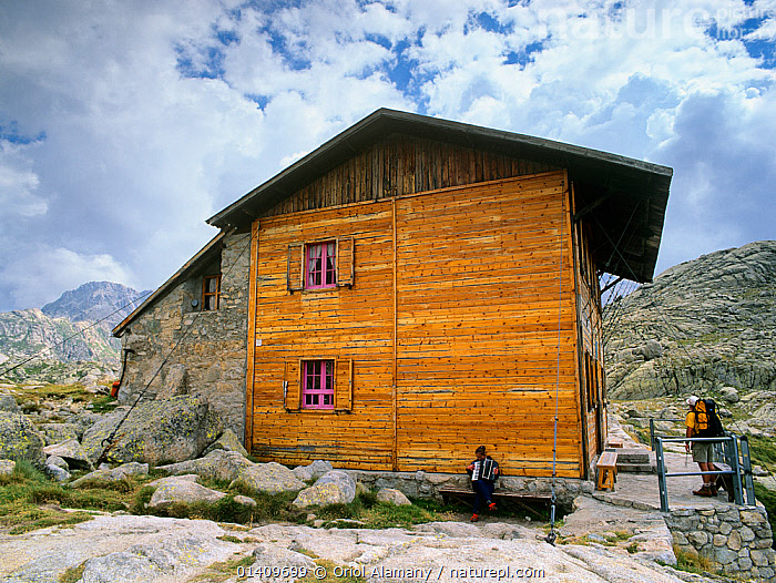 Colomina mountain hut, with man playing the accordian, Aiguestortes i Estany de Sant Maurici National Park, Vall Fosca, Pyrenees Pallars Jussa�, Catalonia, Spain, BUILDINGS,EUROPE,HIKING,INTRUMENTS,MOUNTAINEERING,MOUNTAINS,MUSICAL,PEOPLE,REFUGE,SPAIN,TREKKING,WALKING,SPORTS, Oriol Alamany
